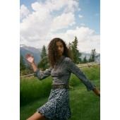 UO Gilly Ruffle Wrap Mini Skirt